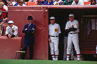 SAN FRANCISCO, CA - Manager Roger Craig and coach Bob Lillis of the San Francisco Giants watch from the dugout during a turn back the clock game against the Chicago Cubs at Candlestick Park in San Francisco, California on June 23, 1991. Standing outside the dugout is Giants executive Jorge Costa. (Photo by Brad Mangin)