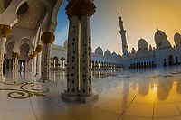 Fisheye perspective of the beautiful Sheikh Zayed Grand Mosque minarets reflecting on the marble floor at sunset, in Abu Dhabi, Asia