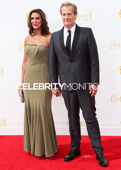 LOS ANGELES, CA, USA - AUGUST 25: Jeff Daniels and wife Kathleen Treado arrive at the 66th Annual Primetime Emmy Awards held at Nokia Theatre L.A. Live on August 25, 2014 in Los Angeles, California, United States. (Photo by Celebrity Monitor)