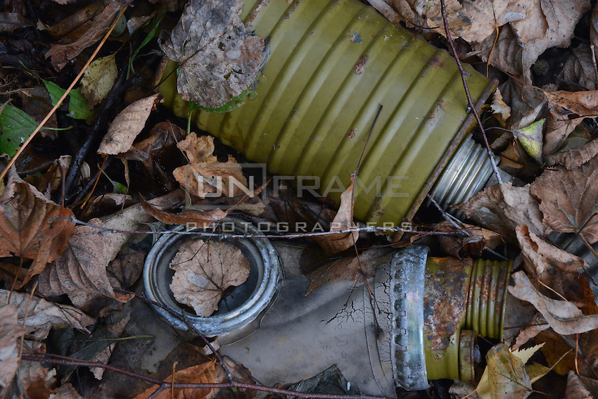 Old model of gas mask used during the times of evacuation and cleaning operations in Prypyat city abandoned after the Chernobyl catastrophe.