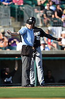 San Antonio Missions hitting coach Francisco Morales (31) argues an interference call with home plate umpire Matthew Czajak during a game against the Arkansas Travelers on May 25, 2014 at Dickey-Stephens Park in Little Rock, Arkansas.  Arkansas defeated San Antonio 3-1.  (Mike Janes/Four Seam Images)
