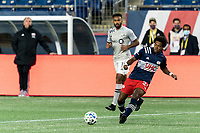FOXBOROUGH, MA - NOVEMBER 20: DeJuan Jones #24 of New England Revolution passes the ball during the Audi 2020 MLS Cup Playoffs, Eastern Conference Play-In Round game between Montreal Impact and New England Revolution at Gillette Stadium on November 20, 2020 in Foxborough, Massachusetts.