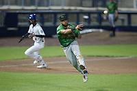 Down East Wood Ducks third baseman Cristian Inoa (4) makes a throw to first base against the Kannapolis Cannon Ballers at Atrium Health Ballpark on May 5, 2021 in Kannapolis, North Carolina. (Brian Westerholt/Four Seam Images)