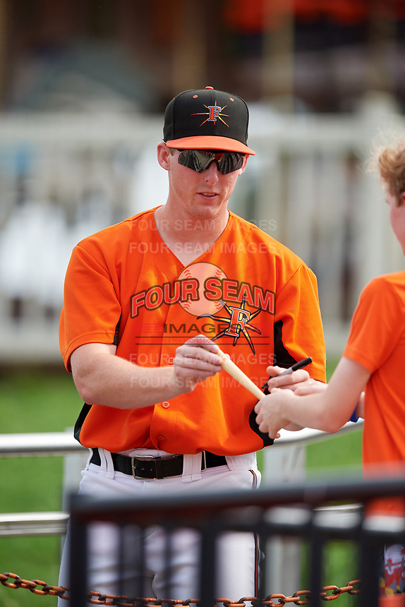 Frederick Keys pitcher Matt Trowbridge (48) signing autographs for fans before the first game of a doubleheader against the Lynchburg Hillcats on June 13, 2018 at Nymeo Field at Harry Grove Stadium in Frederick, Maryland.  Frederick defeated Lynchburg 3-0.  (Mike Janes/Four Seam Images)