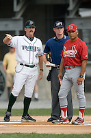 Princeton Manager Jamie Nelson (40) goes over the ground rules with Johnson City Manager Joe Almaraz (30) and home plate umpire Jordan Ferroll at Hunnicutt Field in Princeton, WV, Friday, August 10, 2007.