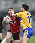 Jonathan Flynn of  Down in action against Sean Collins of Clare during their Division 2, Round 2 National League game at Cusack Park. Photograph by John Kelly.