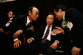 """Seoul, South Korea<br /> May 1, 1987<br /> <br /> Political leader Kim Young Sam (center) attends the formation of a new opposition party.<br /> <br /> After two decades of building an economic miracle, in the summer of 1987 tens of thousands of frustrated South Korean students took to the streets demanding democratic reform. """"People Power"""" Korean-style saw Koreans from all social spectrums join in the protests.<br /> <br /> With the Olympics to be held in South Korea in 1988, President Chun Doo Hwan decided on no political reforms and to choose the ruling party chairman, Roh Tae Woo, as his heir. The protests multiplied and after 3 weeks Chun conceded releasing oppositionist Kim Dae Jung from his 55th house arrest and shaking hands with opposition leader Kim Young Sam. Days later he endorsed presidential elections and an amnesty for nearly 3,000 political prisoners. It marked the first genuine initiative of democratic reform in South Korea and the people had their victory."""
