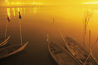 India. Uttar Pradesh state. Allahabad. Maha Kumbh Mela. A view on four boats on the river Ganges at night. The Kumbh Mela, believed to be the largest religious gathering is held every 12 years on the banks of the 'Sangam'- the confluence of the holy rivers Ganga, Yamuna and the mythical Saraswati. The Maha (great) Kumbh Mela, which comes after 12 Purna Kumbh Mela, or 144 years, is always held at Allahabad. Uttar Pradesh (abbreviated U.P.) is a state located in northern India. 11.02.13 © 2013 Didier Ruef