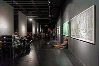 "Pictured: A woman sits on the floor. Saturday 21 September 2019<br /> Re: Concert for the exhibition of ""No More Shall We Part, 14 Paintings, 17 Years Later"", a collection of paintings based on the Nick Cave and the Bad Seeds album with the same name, by Stefanos Rokos at Bernerts Gallery in Antwerp, Belgium."