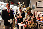 B Trooper, Jerry Hogan, right, reads program for the rededication ceremony of the 1st Squadron, 9th Cavalry monument at Motts Military Museum in Groveport, Ohio.