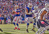12 October 2014: Buffalo Bills quarterback Kyle Orton looks for a receiver in the end zone during a game against the New England Patriots at Ralph Wilson Stadium in Orchard Park, NY. The Patriots defeated the Bills 37-22 to move into first place in the AFC Eastern Division. Mandatory Credit: Ed Wolfstein Photo *** RAW (NEF) Image File Available ***