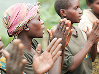 A woman of a Batwa tribe taking part in a welcome dance. The Batwa are a pygmy people who were the oldest recorded inhabitants of the Great Lakes region of central Africa. South West Uganda