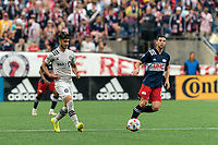 FOXBOROUGH, MA - JULY 25: Emanuel Maciel #25 of CF Montreal passes the ball during a game between CF Montreal and New England Revolution at Gillette Stadium on July 25, 2021 in Foxborough, Massachusetts.