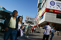 CHINA. Beijing. Shoppers on the Wangfujing shopping street in central Beijing. 2006.