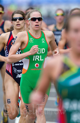 31 MAY 2014 - LONDON, GBR - Aileen Reid (IRL) (centre, in green with white and orange) of Ireland begins her first run lap during the 2014 ITU World Triathlon Series round in Hyde Park in London, Great Britain (PHOTO COPYRIGHT © 2014 NIGEL FARROW, ALL RIGHTS RESERVED)