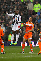 Pictured: Steven Caulker of Swansea (R) watches on as Marc-Antoine Fortune (L) of West Bromwich heads the ball away. Saturday, 04 February 2012<br /> Re: Premier League football, West Bromwich Albion v Swansea City FC v at the Hawthorns Stadium, Birmingham, West Midlands.