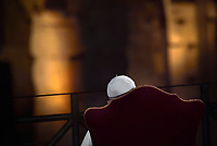 Pope Francis prays during the Via Crucis (Way of the Cross) torchlight procession at the ancient Colosseum (Colosseo, Colisee) on Good Friday, on April 19, 2019 in Rome.