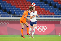 YOKOHAMA, JAPAN - JULY 30: Samantha Mewis #3 of the United States heads the ball during a game between Netherlands and USWNT at International Stadium Yokohama on July 30, 2021 in Yokohama, Japan.