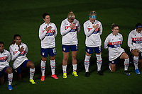 ORLANDO CITY, FL - FEBRUARY 18: Carli Lloyd #10, Lindsey Horan #9 and Julie Ertz #8 stand during the National Anthem during a game between Canada and USWNT at Exploria stadium on February 18, 2021 in Orlando City, Florida.