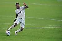 WASHINGTON, DC - AUGUST 25: Cristian Penilla #70 of New England Revolution moves the ball during a game between New England Revolution and D.C. United at Audi Field on August 25, 2020 in Washington, DC.
