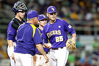 LSU Tigers pitcher Joey Bourgeois #25 meets on the mound with manager Paul Mineri, catcher Ty Ross, and third baseman Tyler Hanover against the Mississippi State Bulldogs during the NCAA baseball game on March 17, 2012 at Alex Box Stadium in Baton Rouge, Louisiana. The 10th-ranked LSU Tigers beat #21 Mississippi State, 4-3. (Andrew Woolley / Four Seam Images).