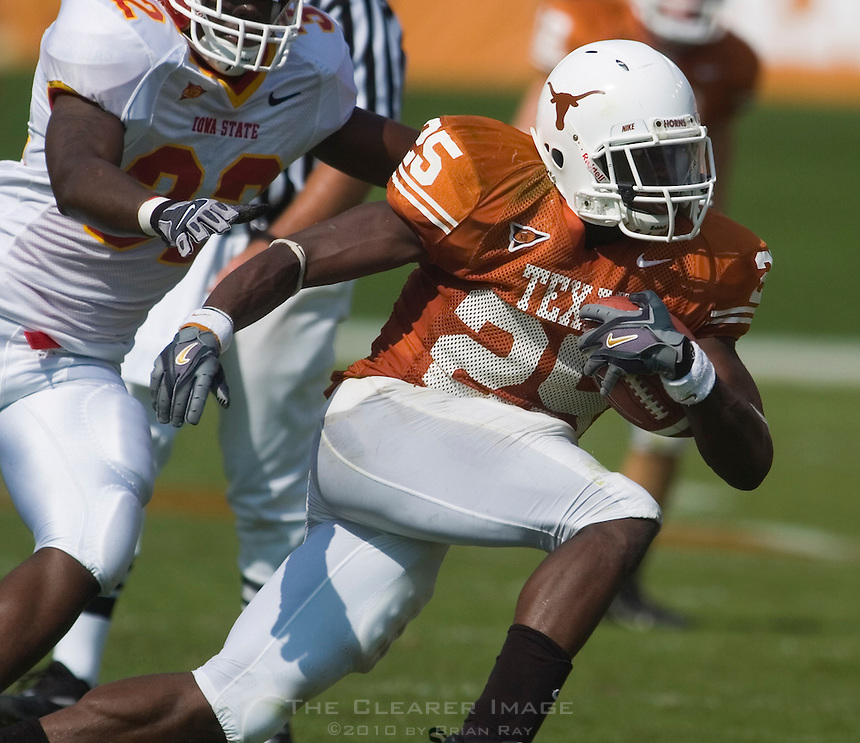 23 September 2006: Texas back Jamaal Charles (#25) dodges a tackle by Iowa State defender Josh Raven (#32) during the Longhorns 37-14 victory over the Iowa State Cyclones at Darrell K Royal Memorial Stadium in Austin, TX.