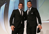 LONDON, ENGLAND - NOVEMBER 01:  (L-R) Richie McCaw presents teammate Sonny Bill Williams of New Zealand a replacement winners medal for the one that he gave to young fan Charlie Lines during the World Rugby Awards 2015 at Battersea Evolution on November 1, 2015 in London, England.  (Photo: World Rugby)