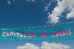 Climate Camp Blackheath south London UK. Capitalism IS Crisis banner.