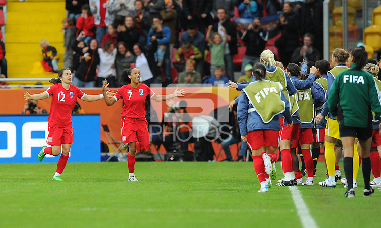 Jessica Clarke (2nd left) of team England celebrates with Karen Carney (l) during the FIFA Women's World Cup at the FIFA Stadium in Dresden, Germany on July 1st, 2011.