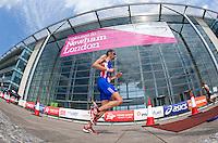 31 JUL 2011 - LONDON, GBR - Stuart Hayes passes Building 1000 on the run of the Elite Men's race during the Virgin Active London Triathlon (PHOTO (C) NIGEL FARROW)