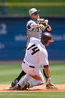 Shortstop Derek Dietrich #32 of the Georgia Tech Yellow Jackets turns a double play as Andrew Lawrence #14 of the Boston College Eagles tries to break it up at Durham Bulls Athletic Park May 21, 2009 in Durham, North Carolina.  (Photo by Brian Westerholt / Four Seam Images)