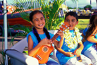 Children adorned with leis and a ukulele participate in a parade for the annual Aloha Week Festival.These photos taken on the island of Maui predeeding the parade.