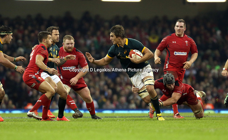 Pictured: Eben Etzebeth of South Africa (C) is brought down by dan Lydiate of Wales Saturday 29 November 2014<br /> Re: Dove Men Series 2014 rugby, Wales v South Africa at the Millennium Stadium, Cardiff, south Wales, UK.