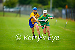 Kerry's Amy O'Sullivan tries to get past Deanna Considine of Clare in the Munster Junior Camogie final