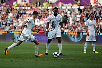 (L-R) Tom Carroll of Swansea City takes a shot in front of team mate Leroy Fer during the Premier League match between Swansea City and Watford at The Liberty Stadium, Swansea, Wales, UK. Saturday 23 September 2017