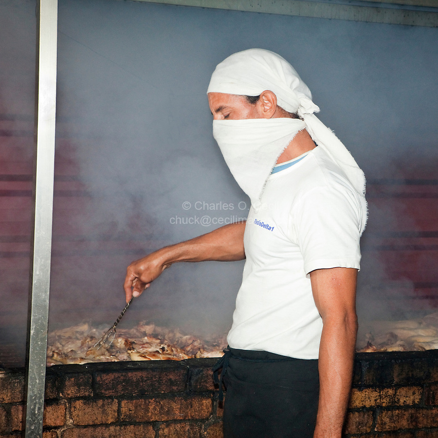 Cuba, Havana.  Cook Preparing Lunch, Barbecuing Chicken and Beef, at Cafe at Handicrafts Market.