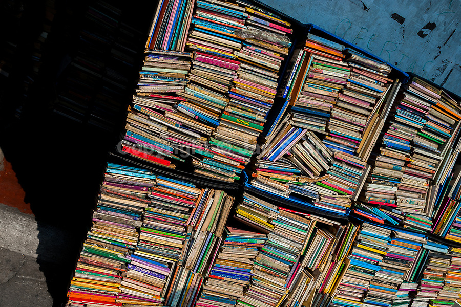 Hundreds of used books are seen stacked in boxes on the street in a secondhand bookshop in San Salvador, El Salvador, 10 April 2018. Large collections of worn-out books, mostly textbooks and educational paperbacks, are sold regularly in secondhand bookshops in the center of the city.