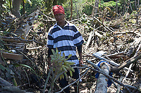 A volunteer searches through debris for missing persons following the tsunami. More than 170 people died when a tsunami triggered by an 8.3 magnitude earthquake hit Samoa and neighbouring Pacific islands on 29/09/2009. Samoa (formerly known as Western Samoa)..