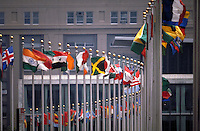 United Nations Building in New York circular display of international flags flying.