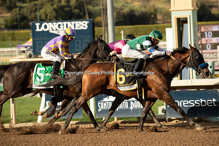 ARCADIA, CA  MARCH 7: #6 Combatant, ridden by Joel Rosario, passes #5 Midcourt, ridden by Victor Espinoza, and #1 Multiplier, ridden by Tyler Gaffalione, to win the Santa Anita Handicap (Grade l) on March 7, 2020, at Santa Anita Park in Arcadia, CA. (Photo by Casey Phillips/Eclipse Sportswire/CSM