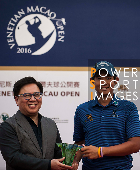 Pavit Tangkamolprasert of Thailand is presented with a souvenir after winning the Venetian Macao Open 2016 at the Macau Golf and Country Club on 16 October 2016 in Macau, China. Photo by Marcio Machado / Power Sport Images
