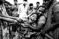 People mourn for their relatives, who are trapped inside the rubble of the collapsed Rana Plaza building, in Savar. near Dhaka, Bangladesh.