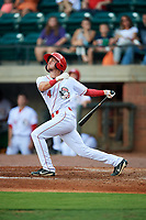 Greeneville Reds third baseman Claudio Finol (4) follows through on a swing during a game against the Pulaski Yankees on July 27, 2018 at Pioneer Park in Tusculum, Tennessee.  Greeneville defeated Pulaski 3-2.  (Mike Janes/Four Seam Images)