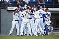 Vinnie Pasquantino (33) of the Burlington Royals is greeted by teammates after scoring a run during the game against the Johnson City Cardinals at Burlington Athletic Stadium on September 4, 2019 in Burlington, North Carolina. The Cardinals defeated the Royals 8-6 to win the 2019 Appalachian League Championship. (Brian Westerholt/Four Seam Images)