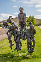 """""""New Heights"""" is a scuplture of  happy children bouncing on pogo sticks.  The creation of artist Gary Lee Price, this installation resides in front of a senior center in Green River, Wyoming."""
