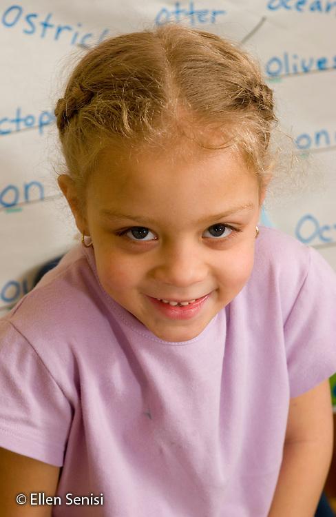MR / Schenectady, NY.Zoller School (urban elementary public school) Kindergarten.Portrait of girl. (6, African-American/Caucasian).MR: Buf1.© Ellen B. Senisi