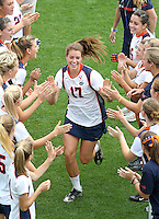 The University of Virginia women's lacrosse player Brittany Kalkstein runs through the huddle at the start of their first game since the tragic death of teammate Yeardley Love Sunday May 16, 2010 at Klockner Stadium in Charlottesville, Va. The Cavaliers rallied in the last four minutes to beat Towson 14-12 and reach the quarter finals of the NCAA tournament. Love's body was found May 3, and Virginia men's lacrosse player George Huguely is charged with murder. Photo/Andrew Shurtleff..