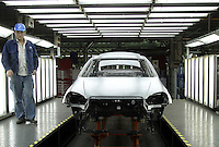 A Chinese technician checks a unfinshed body of a Buick during quality audit at the Shanghai General Motors (SGM) plant in Shanghai, China. SGM is a joint-venture between General Motors and the Shanghai Automotive Industry Corporation also known as SAIC..