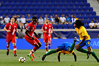 Harrison, NJ - Friday July 07, 2017: Alphonso Davies, Loic Baal, Rhudy Evens during a 2017 CONCACAF Gold Cup Group A match between the men's national teams of French Guiana (GUF) and Canada (CAN) at Red Bull Arena.