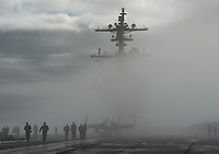111011-N-DR144-515 SAN FRANCISCO (Oct. 11, 2011) Sailors transit the flight deck as Nimitz-class aircraft carrier USS Carl Vinson (CVN 70) passes through a fog bank while departing San Francisco. Carl Vinson was anchored in San Francisco, the ship's original homeport, participating in Fleet Week festivities.  U.S. Navy photo by Mass Communication Specialist 2nd Class James R. Evans (RELEASED)